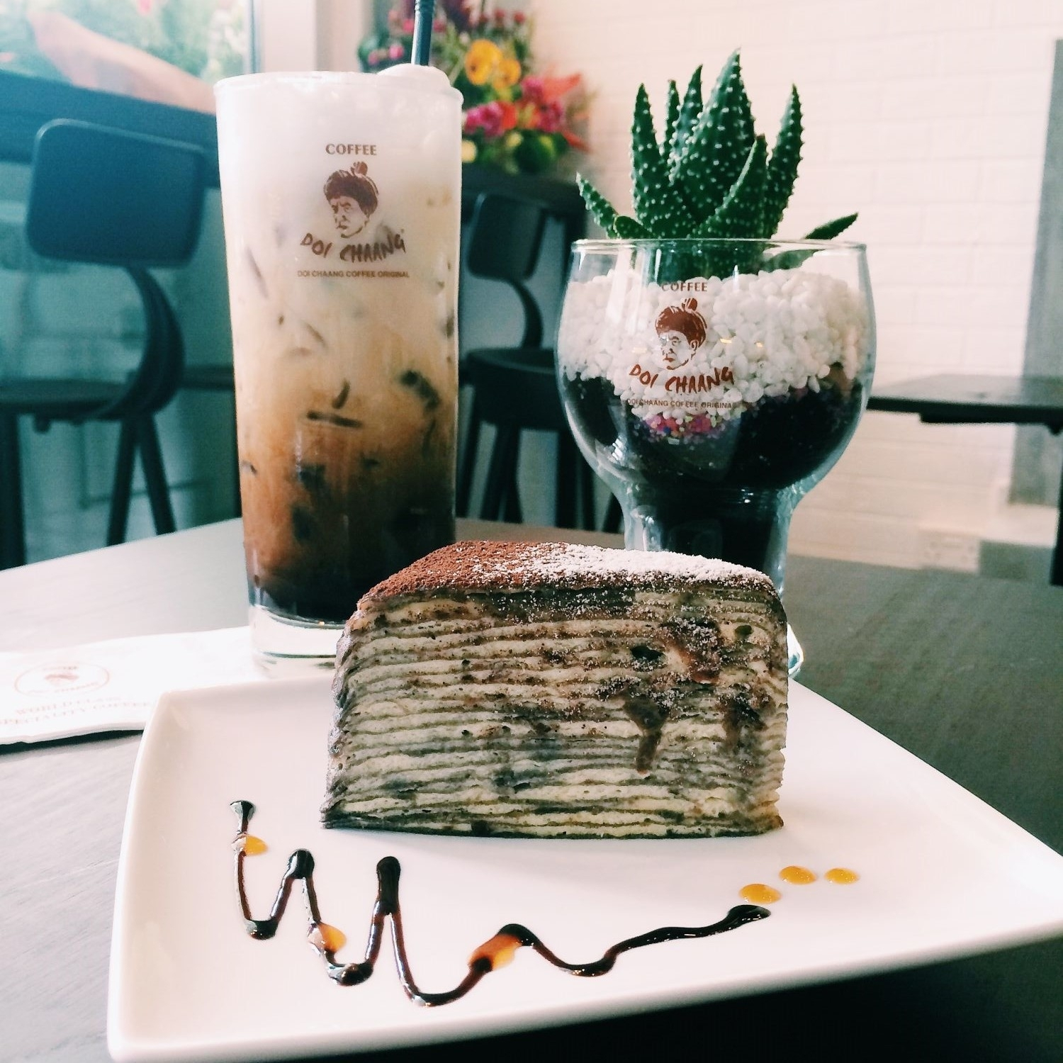 Iced Doi Chaang Coffee with Rum and Raisin Mille Crepe Cake - Doi Chaang