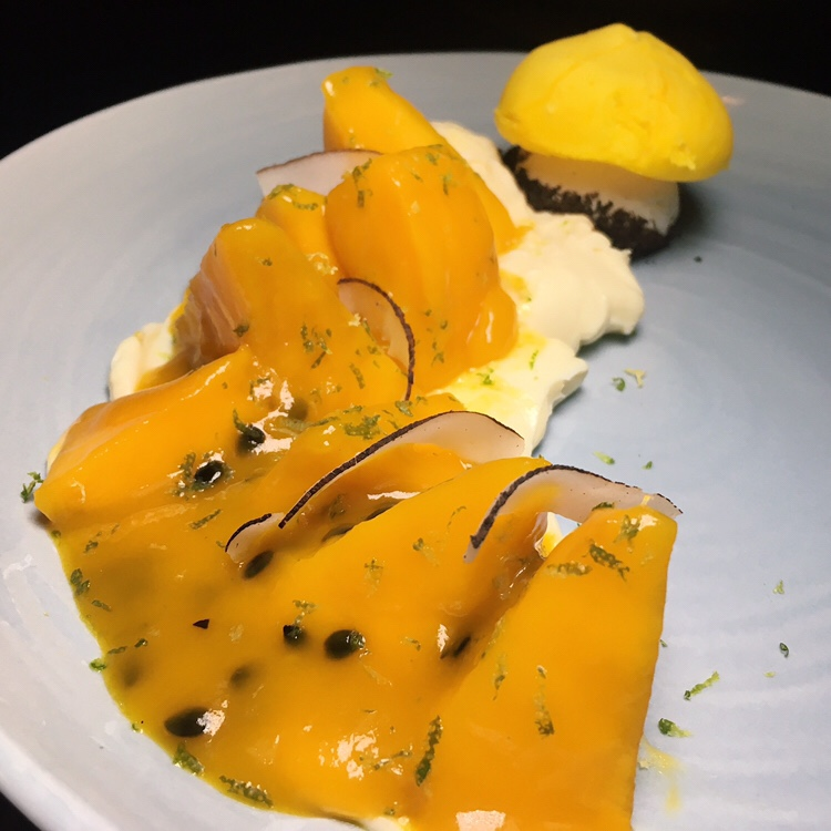 Passionfruit Swirl Pavlova and Toasted Coconut - Origin Grill & Bar