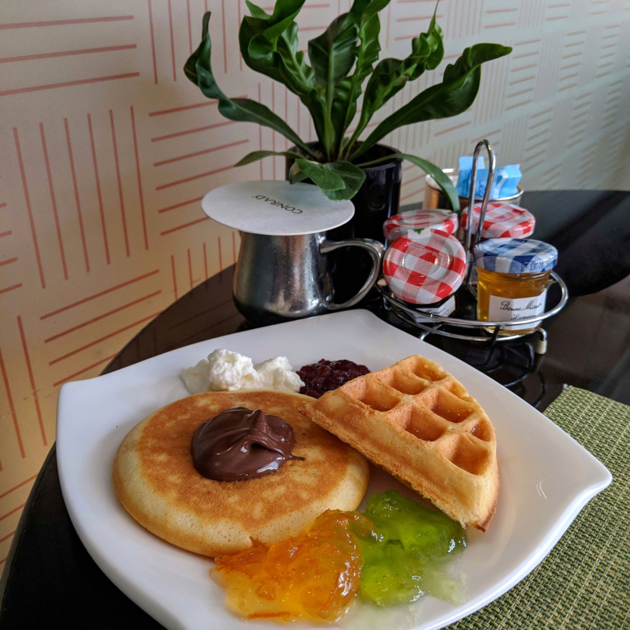 conrad centennial singapore oscars breakfast waffle pancake