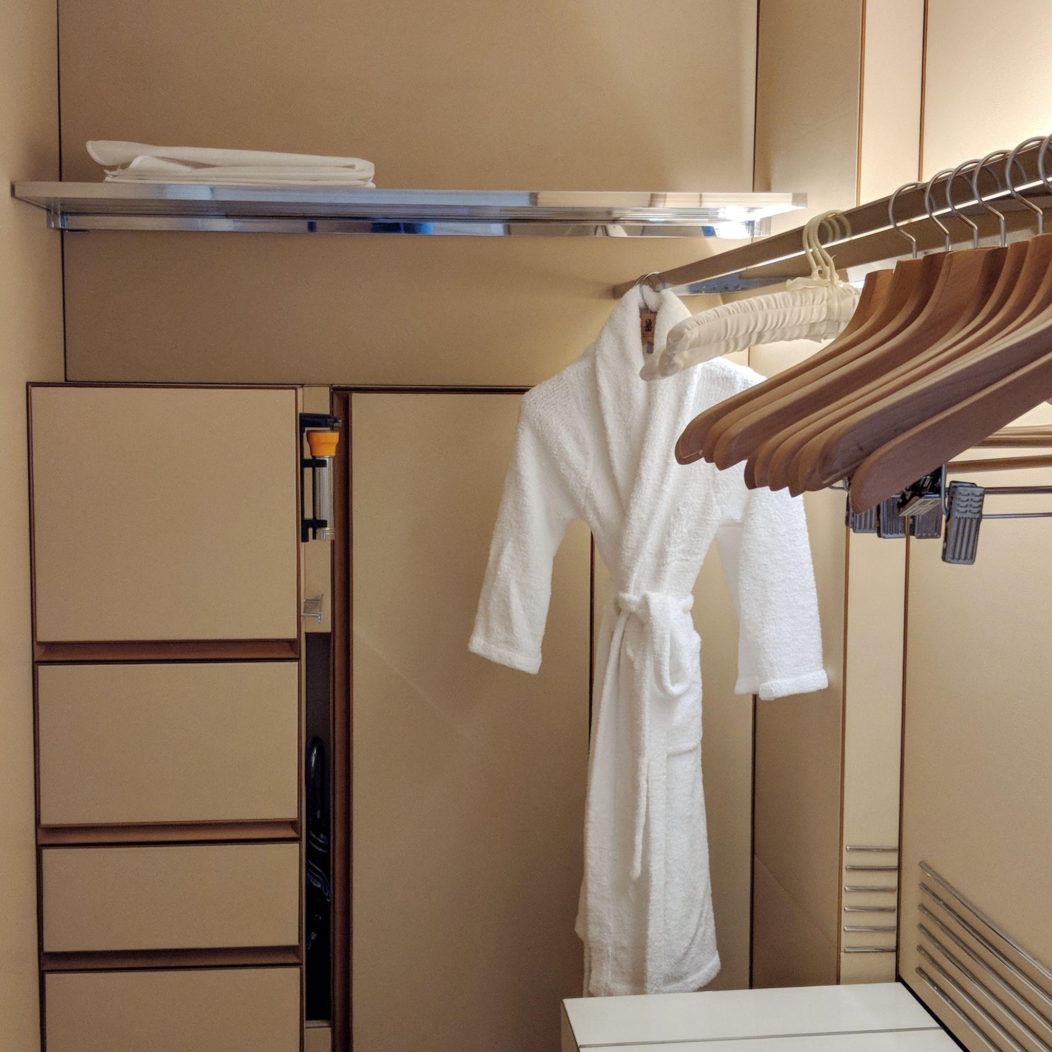 the ritz-carlton, millenia singapore one-bedroom millenia suite walk-in wardrobe