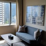 oakwood premier oue singapore one bedroom executive apartment living room