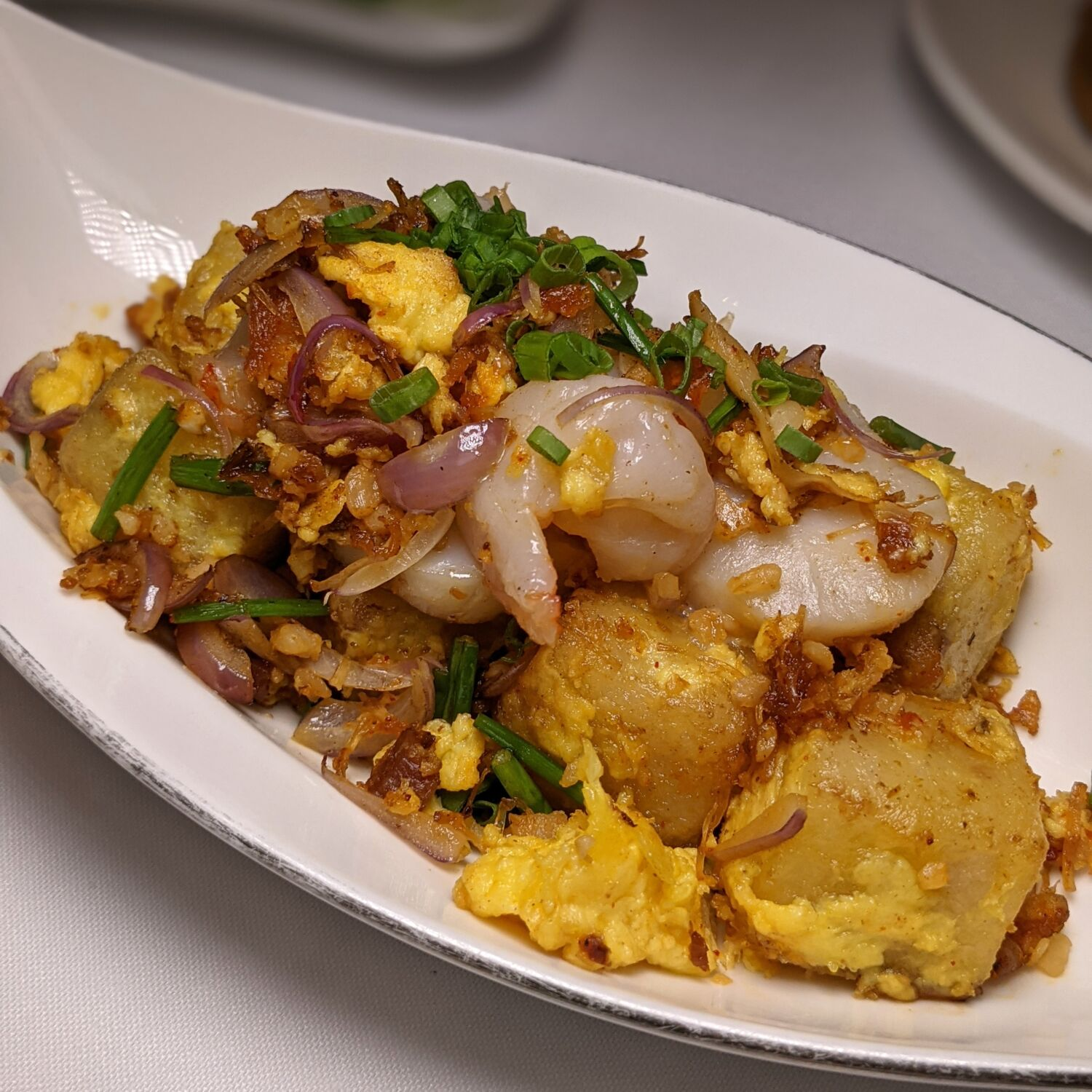 Capella Singapore Cassia Wok-fried Carrot Cake with Chinese Sausage, Prawn and Scallop in XO Chilli Sauce